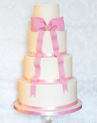 Pink Bow and Ribbon Wedding Cake